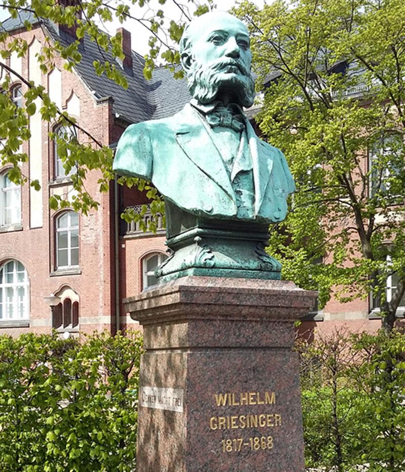 Wilhelm Griesinger vor der alten Psychatrie - einer der Begründer der modernen Psychiatrie