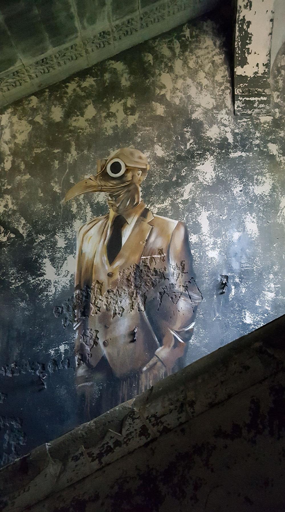 Der Vogelmann - Graffiti in einem Treppenaufgang